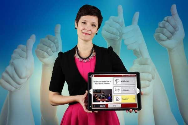 Dr. Kramer holding a tablet displaying PEDI-PRO app